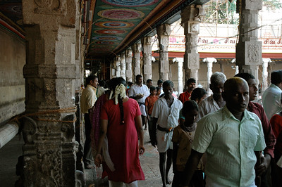 a steady stream of people visit the temple to offer prayer. ('Chitirai Thiruvizha' in Madurai.)