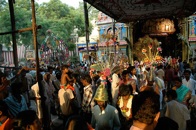 At the temple, a huge crowd is gathering, many in costume. ('Chitirai Thiruvizha' in Madurai.)