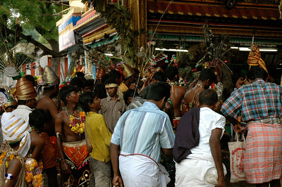 at the entrance, boys and men are squirting everyone with water. ('Chitirai Thiruvizha' in Madurai.)