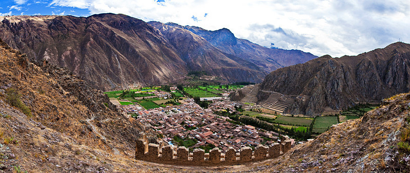 Panorama of Ollantaytambo.<br /> <br /> The terraces on the opposite hill are part of the Ollantaytambo fortress. The brick structures near the bottom of the picture are part of the ruins of Inca grain stores on a hill behind the town.