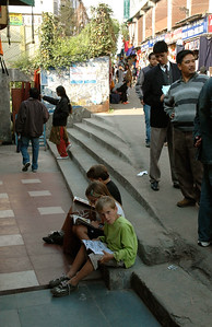 The kids reading their new books beside the street in Darjeeling.  They had many onlookers.