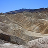 View from Zabriskie Point. It is possible to go out and hike on the ridges as seen from the traffic paths.