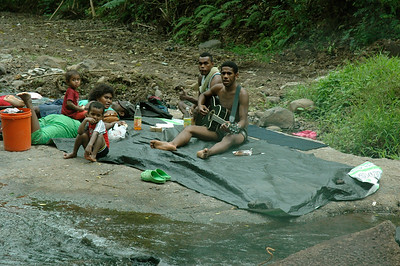 a family picnic and washing-day at the stream crossing outside Lautoka, Fiji.