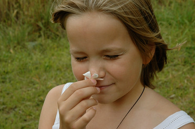 Mara finds a beautiful flower in the hills above Nadi, in the village of Abaca. (Fiji.)