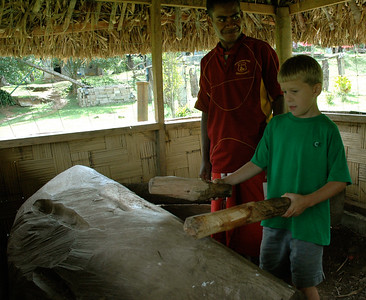 Fiji. Andy learns how to use the drums at the village of Abaca. Letia is our village guide.