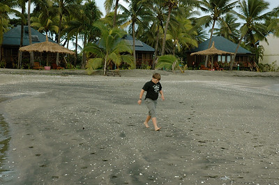 John explores the beach at Club Fiji, near Nadi.