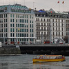 "View across the Rhone to one of numerous watch nameplate buildings allong the quais in downtown Geneva. The boats are considered ""transit"" and have specific routes."