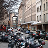 Moped parking in the shopping district between the old town (hill and ramparts) and the river Rhone.