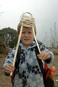 Himalaya Trek: Andy finds some split bamboo and starts to make a snowshoe.