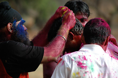 Students celebrate Holi at IISc: colored powder for a newcomer.