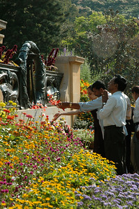 IISc Founder's Day celebration; people toss flower petals at the base of the statue, and pay respects to Tata.