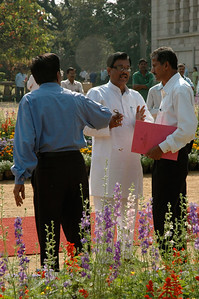 IISc Founder's Day celebration; the Director (in blue) tries to appease an angry atendee.
