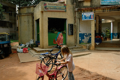 Mara stops at the mini-bazaar, a marketplace for vegies, fruits, candy, bread, milk, household sundries, barber shop, beauty shop, and tailor.