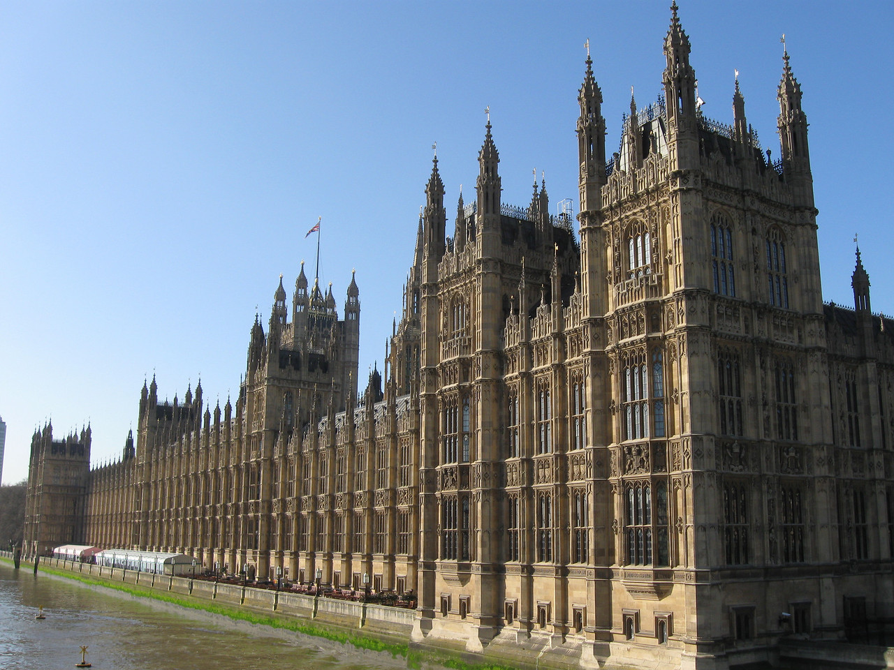 The  Houses of Parliment building along the Thames River in London, England. Also, referred to as Palace of Westminster or Westminster Palace.