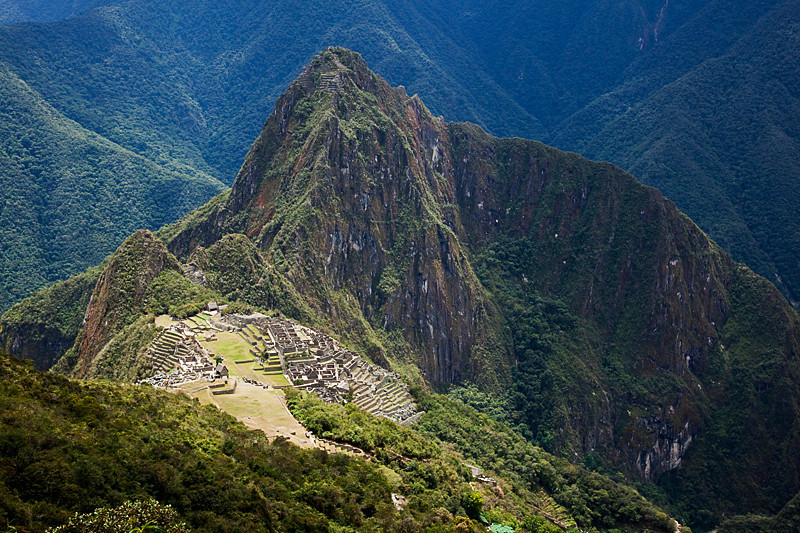 View of Machu Picchu on the way up Machu Picchu mountain.<br /> <br /> This is my third time visiting MP. I was staying in Ollantaytambo and decided on my last day there that I wanted to climb Machu Picchu Mountain. Ollantaytambo is the town nearest to MP, so if I was ever going to revisit MP during this trip I needed to do it then. I bought a round trip train ticket that very morning and here I was, back at MP again :).