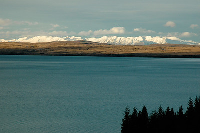 Lake Pukaki dominates the fore as the alps span the view. New Zealand south island.