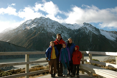 Family photo at Kea Point in the shadow of Mt. Cook range in Aoraki National Park, New Zealand.