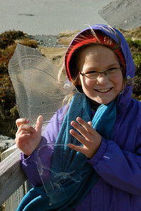 Mara shows me some fresh ice at Kea Point in the shadow of Mt. Cook range in Aoraki National Park, New Zealand.