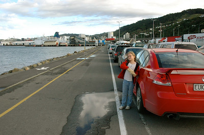 New Zealand: Mara waits for the ferry across Cook Strait. Note our red `cop-magnet' rental car.