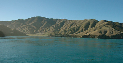 New Zealand Cook Strait: with tiny villages and farms nestled in the rolling hills.
