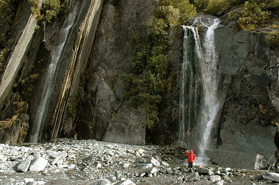 Andy shows me some waterfalls near the Franz Josef glacier, New Zealand.