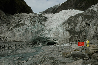 Danger signs warn us of icefall and rockfall... South Island, New Zealand.