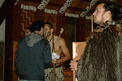 Te Puia - the traditional greeting, touching nose and forehead. (Rotorua, New Zealand)