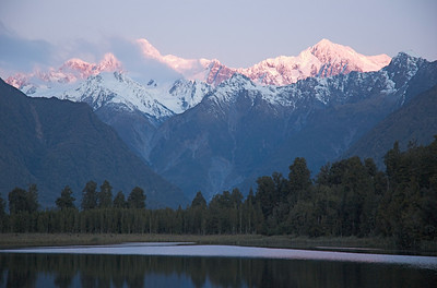 Mt. Cook and Mt. Tasman, from the west. Town of Fox Glacier. Lake Matheson.