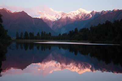 New Zealand. South Island. Mt. Cook and Mt. Tasman, from the west. Town of Fox Glacier. Lake Matheson.