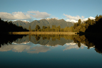 Lake Matheson draws photographers for its reflections.