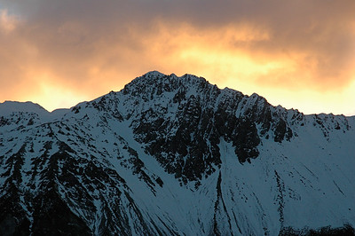 At sunrise, a ridge near Aoraki bursts into backlit flame. New Zealand south island.