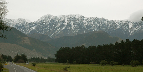our first glimpse of the southern alps – and the best is yet to come.  New Zealand. South Island, east coast.