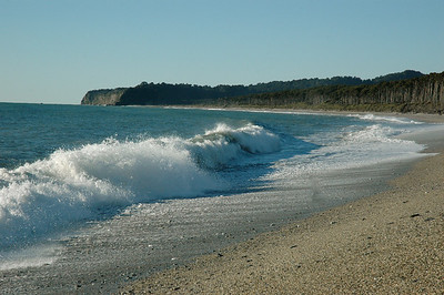 Beaches, which are uncommon, are pebbles and smooth rocks. South Island, New Zealand.