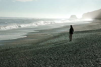 At Greymouth, Pam strolls on the beach. South Island, New Zealand.