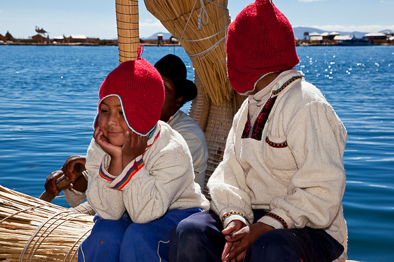 Islas Los Uros, Lake Titicaca.<br /> <br /> The two boys were singing songs in multiple languages. One thing you'll learn fast enough in Peru is that almost nothing is free. As soon as the boys finished their sing song, they went around to the passengers asking for tips.