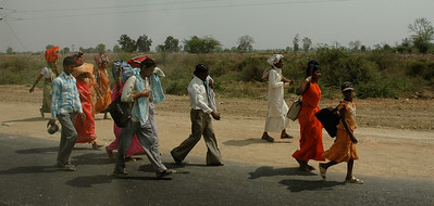 On our way to Agra: pilgrims walking along the roadside.