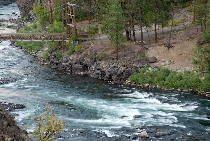 tripod on rocks above Spokane River