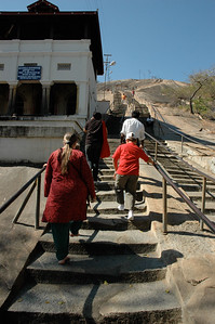We climb the carved steps to the temple at Shravanabelagola; it is 614 steps to the top, each one cut directly into the rock.