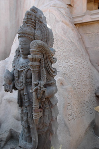 Shravanabelagola: one of the guardian statues beside the foot of the giant statue; also, an old inscription.