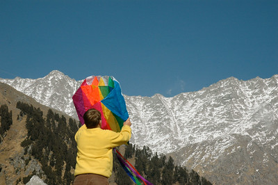 John helps me fly a kite at Triund pass in Dharamsala.