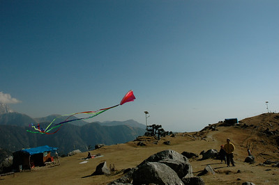 Every time I hike a mountain I carry this small, packable kite. Flying our kite at Triund - Dharamsala.