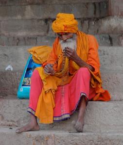 Varanasi: at sunrise, a holy man sits on the ghat.