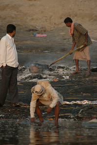 Varanasi sunrise: cleanup at the cremation ghat is for the lowest caste.