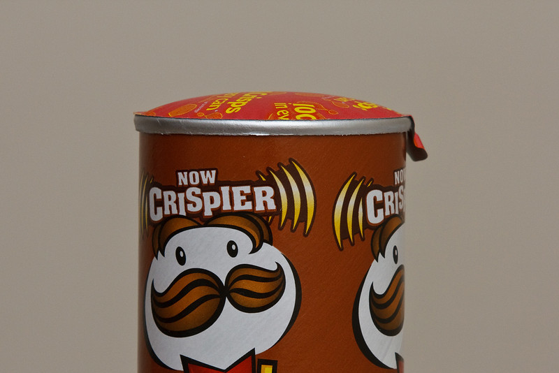 The low-pressure of the high-altitude caused the vacuum-packed Pringles to bulge up.