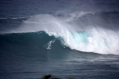 Surfer riding the curl Jaws Mui