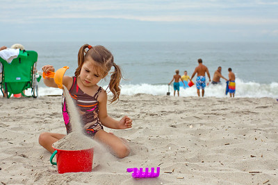 Who knew that over filling a plastic bucket with sand could be such a focused activity?