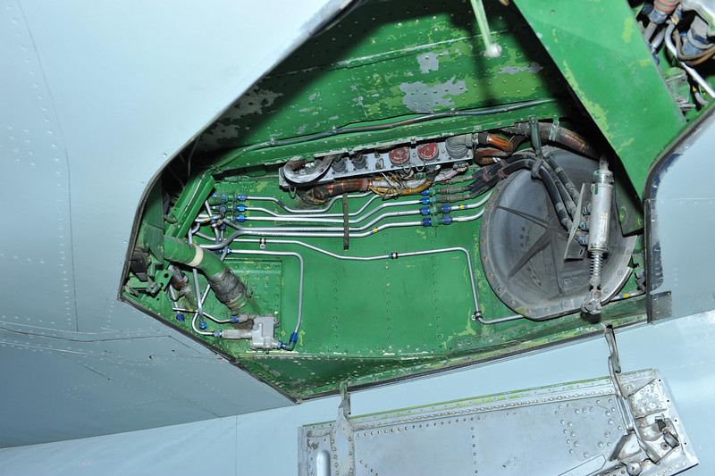 F-105 left wheel well.  Electrical connectors were moved from one point to another depending on the weapons configuration.  Note jet engine intake on the lower right. of the wheel well.