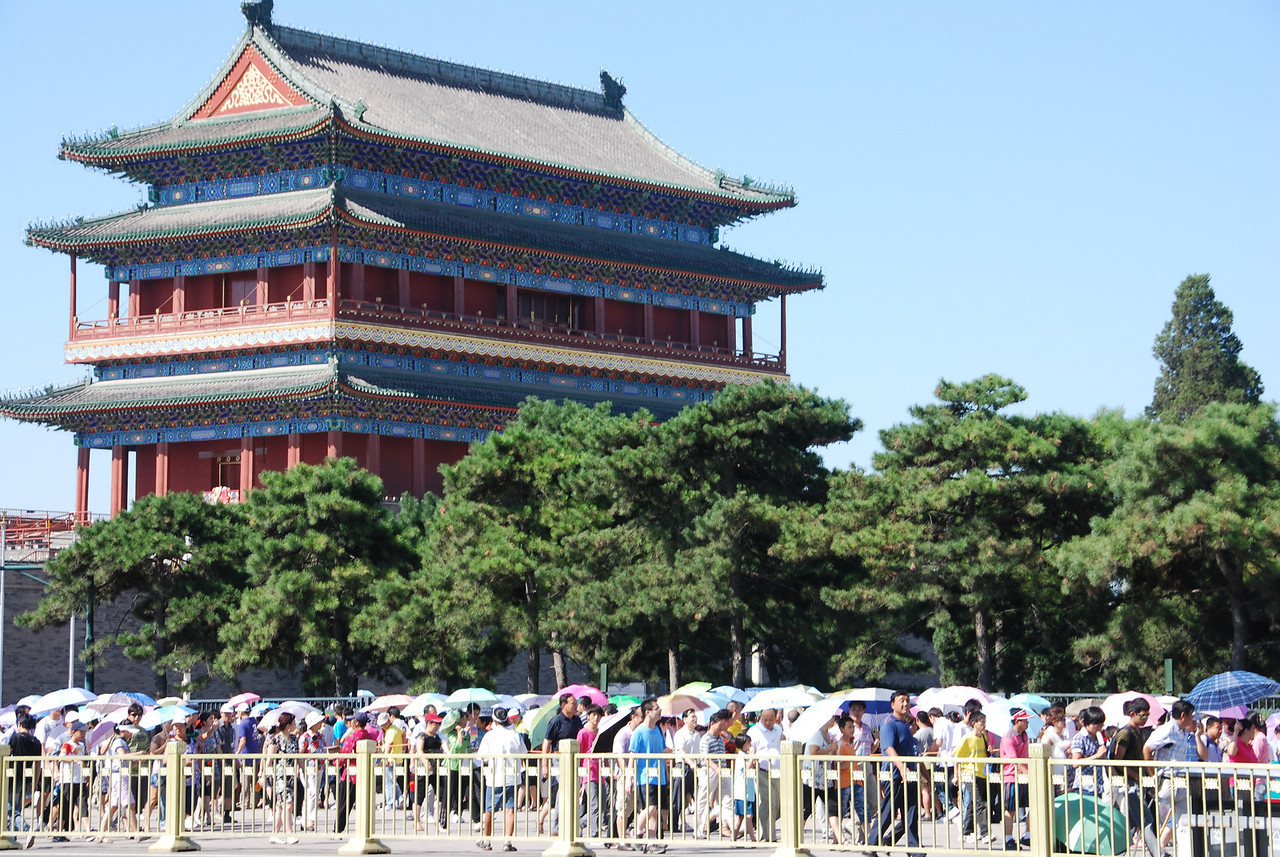 Very hot - crowds with umbrellas at Tiananmen Square. Larry thinks all 1.3 billion people are visiting here today!