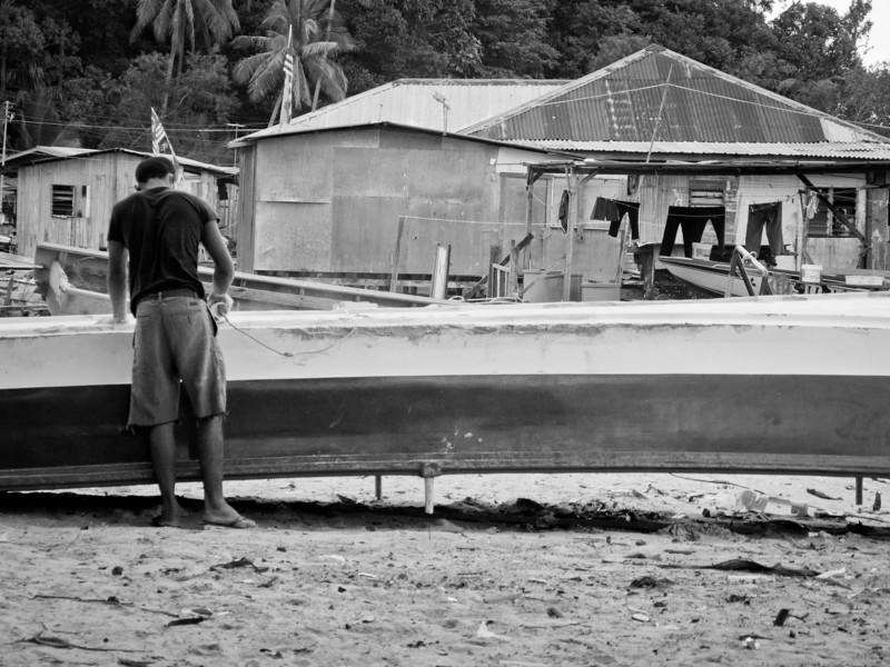 A skilled person repairing a boat in Pulau Gaya, Sabah.