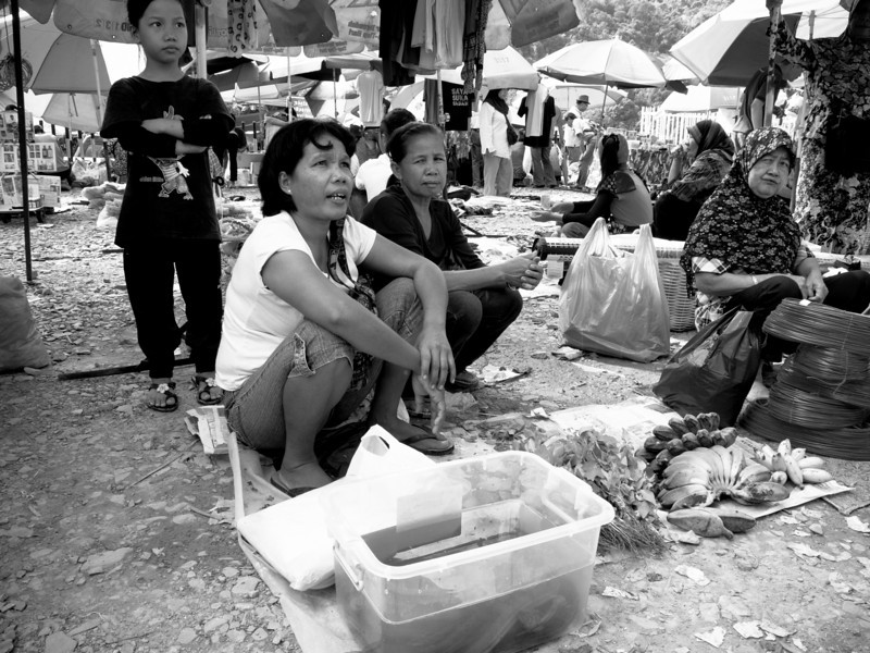 A woman selling eels caught from paddy field in Tamparuli, Sabah.
